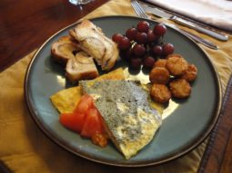 salmon fritatta with bread, potatoes and grapes