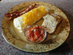 breakfast burrito with salsa, bread and bacon