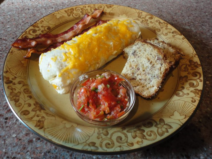 breakfast burrito with salsa, bread and bacon
