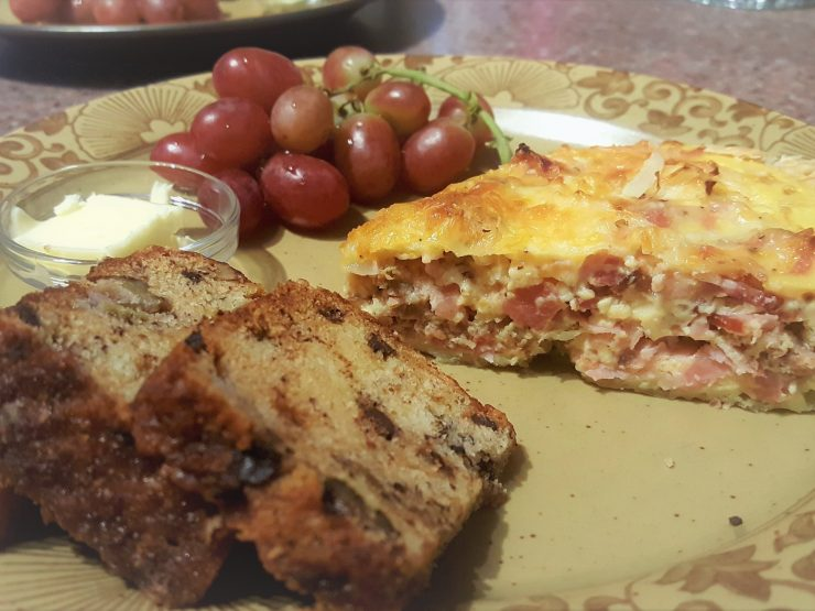 meat lover's quiche, raisin bread with butter and grapes