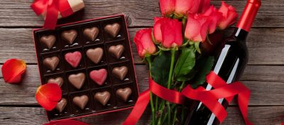 heart-shaped chocolates, roses and bottle of wine