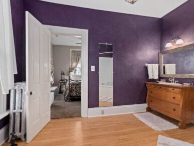 Brayton bathroom with vanity and purple walls
