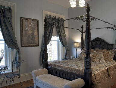 Blue Room with ornate 4-poster bed, table and chair