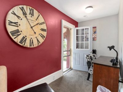 Casa office with red and white walls, large clock