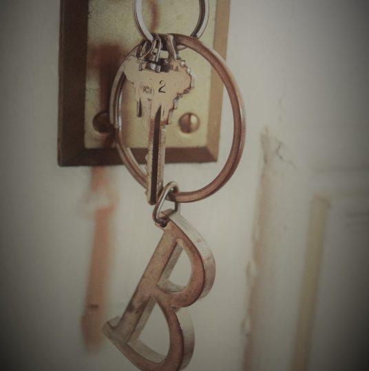 key in door and keys on keychain