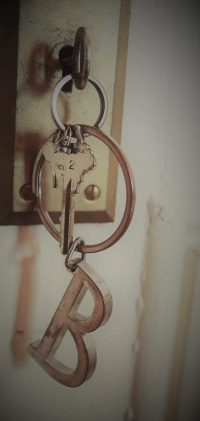 key in door and keys on keychain