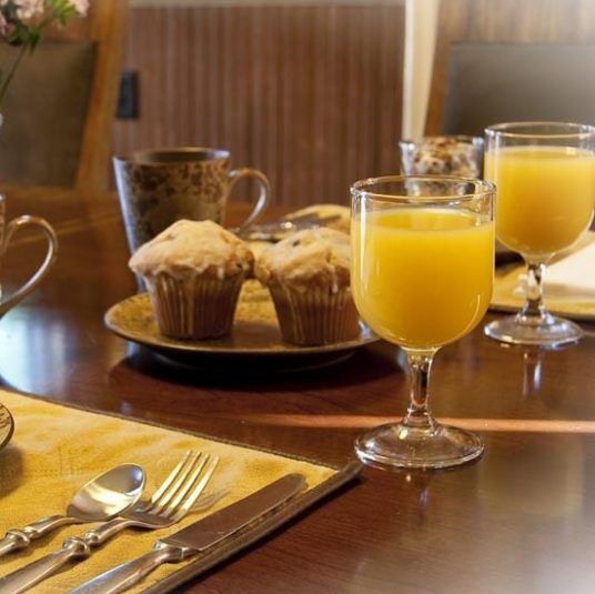breakfast with orange juice and muffins