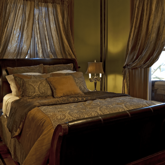 John Rich Room with sleigh bed and green walls