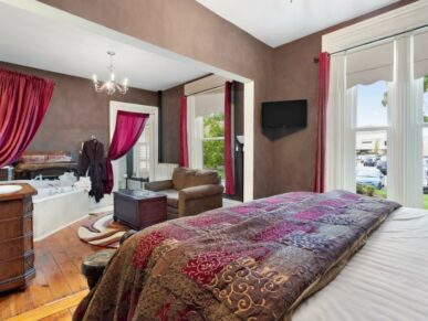 Belle Suite with bed, chair, chest and bathtub